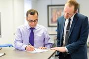 New employment opportunities: an employer and new employee signing an employment contract