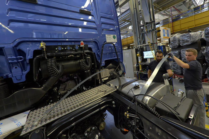 Fuel tanks are mount to the chassis at the assembly line for MAN trucks at the MAN plant in Munich, Germany.